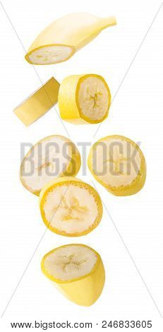 Isolated Flying Bananas. Seven Falling Slised Banana Fruits Isolated On White Background With Clippi