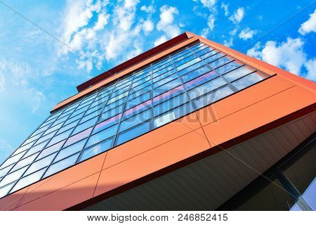 Modern Orange Building With Offices And Glass Windows