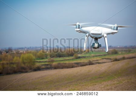drone quad copter on green corn field poster