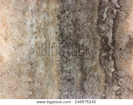 Beautiful glossy marbled surface in beige, brown and cream with patterns and speckles. Marble is a metamorphic rock composed of recrystallized carbonate minerals, most commonly calcite or dolomite. poster