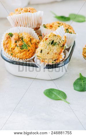 Savory Potato Spinach And Feta Muffins. White Stone Background.