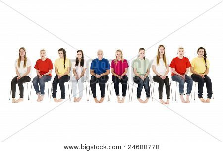 Group Of Young Women On Chairs