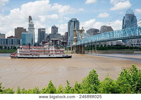 Cincinnati, Ohio - June 24, 2018: Replica steamboat in the Ohio River in Cincinnati. Cincinnati is the 3rd largest city in Ohio and 65th largest city in the USA.