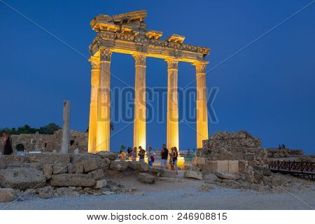 Side, Turkey - June 8, 2018: People at the Temple of Apollo in Side at dusk, Turkey. Side  is an ancient Greek city on the southern Mediterranean coast of Turkey.