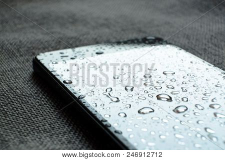 Raindrops On The Glass. Wet Rainy Day. The World Is Reflected In The Drops. The Rain Got The Phone W