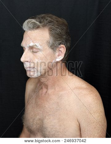 Male Wearing A Light Bentonite Clay Treatment Mask Thin Bentonite Clay Face Treatment Worn By A Guy.