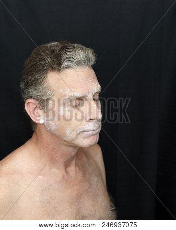 Wearing Thin Bentonite Clay Mask Beauty Treatment. A Man Wearing A Liquid Bentonite Clay Face Mask.