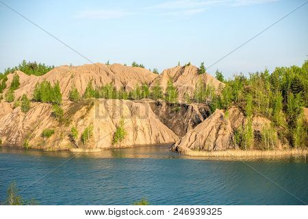 Picture Of Mountainous Area With Green Trees And River On Summer Day
