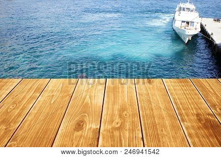 Empty Wooden Table Or Terrace On The Sea Background. Ship Berth On The Shore. Can Be Used As A Table