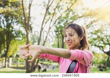 Close Up Of A Young Woman Warm Up Her Body By Stretching Her Arms To Be Ready For Exercising And Do