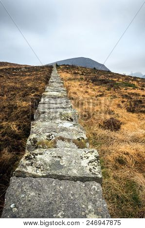 A View Of A Wall Leading To Eagles Mountain In Northern Ireland
