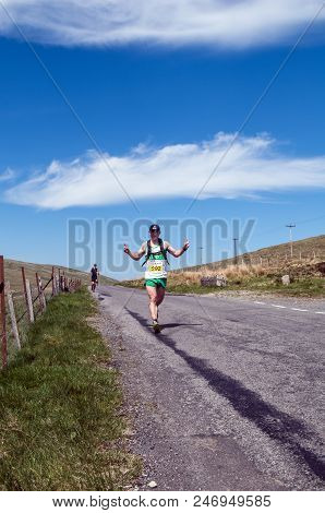 Newcastle, 8th May 2013. A Man Running In The Mourne Way Marathon With His Hands Up.