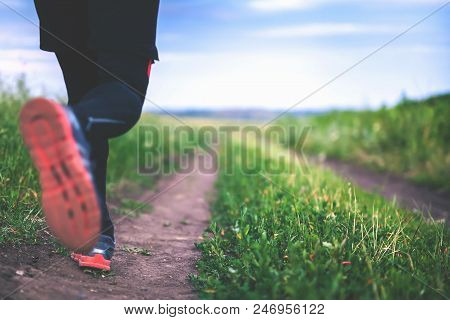 Close-up Jogging And Running Outdoors In Nature. Run People Outdoor. Athlete Wearing In Trainers And