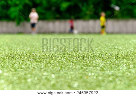 Football Lawn, Three Player In Background. Soccer Closeup Detail Wallpaper Texture.
