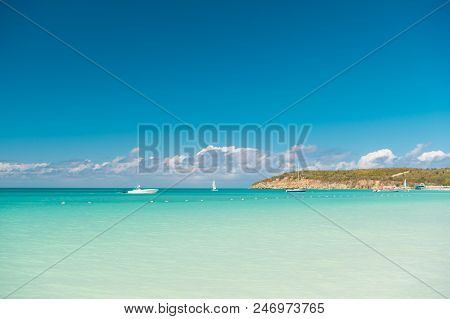Boating And Marine Industry. Travel Ship Touristic Boat Tranquil Lagoon. Sky Over Calm Tropical Sea.