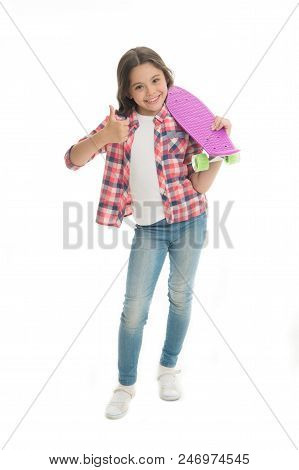 Nice Board. Kid Girl Happy Holds Penny Board. Modern Teen Hobby. Girl Happy Face Carries Penny Board