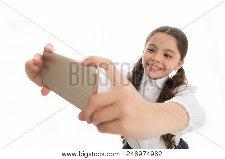 Let Me Take Selfie. Girl Cute Long Curly Hair Holds Smartphone Taking Selfie White Background. Child