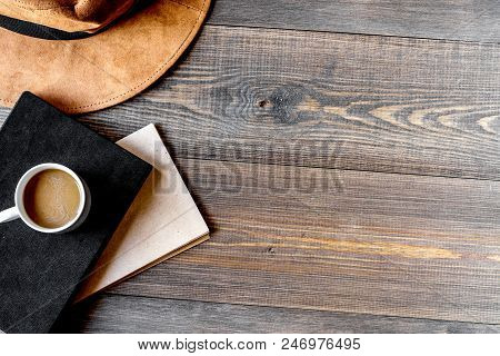 Writer Workplace With Tools, Cofee And Hat On Wooden Table Background Top View Mock Up