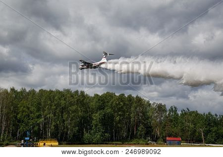 NOGINSK, RUSSIA - JUNE 06, 2018. Aircraft Ilyushin IL-76TD demonstrates aerial firefighting during the international exhibition Complex Safety-2018. Noginsk Rescue Center, Moscow region, Russia.