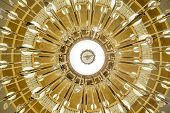 Look up at the golden and white chandelier symmetry harmony magnificent poster