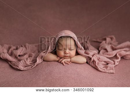 Asian Girl In Arabic Style On A Pink Background.  Sleeping Beautiful Newborn Baby.