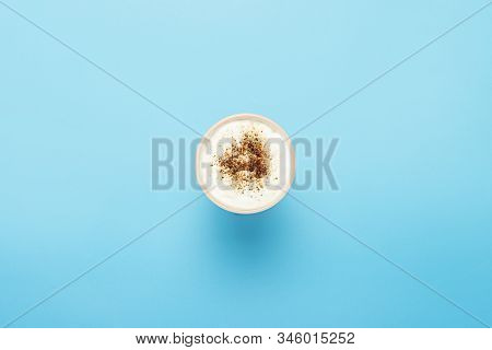 Cup With Cappuccino, Coffee With Froth On A Blue Background. Concept Coffee Shop, Barista, Breakfast