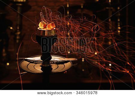 Shisha Hookah Bowl With Red Hot Coals And Craft Tobacco. Modern Hookah With Coconut Charcoal For Rel