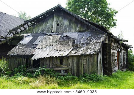 The Building Affected By The Hurricane. An Old Abandoned House With A Ruined Roof