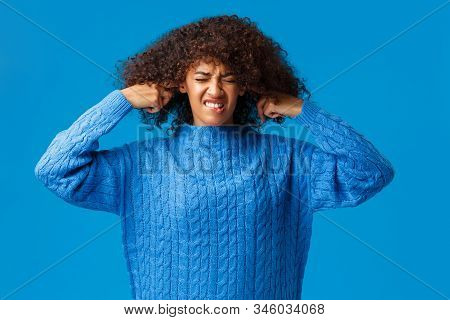 Girl Hate Chrismas Songs Sound Everywhere. Displeased And Bothered African-american Woman Shut Ears