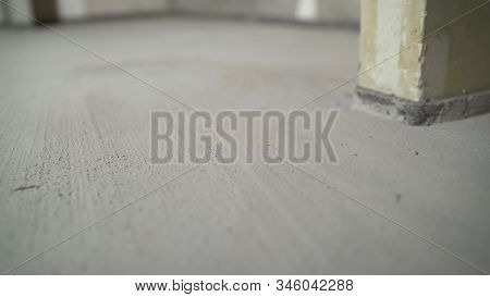 The Worker Finished Leveling The Floors. Smooth Concrete Floor, Work Result