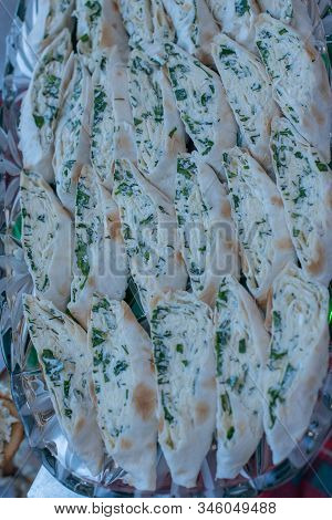 Pita Bread Wrapped With Cottage Cheese And Vegetables. Pita Bread With Cottage Cheese And Herbs
