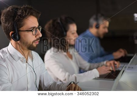 Concentrated Bearded Call Center Operator Working. Thoughtful Call Center Operators During Working P