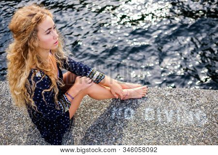Beautiful portrait of a young woman on the lakeside