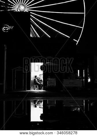 Puebla De Zaragoza, October 12, 2018 - Monochrome Scene Of Modern Building With Two Man And Ferris W