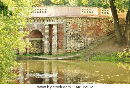Grotto On The Pond's Shore