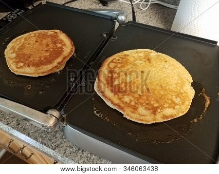 Pancake Cooking On A Griddle Or Stove