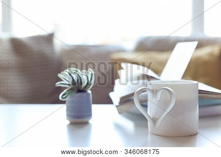 Cup Of Tea With Love Heart Shaped Handle As Metaphor For A Loving And Caring Couple To Share