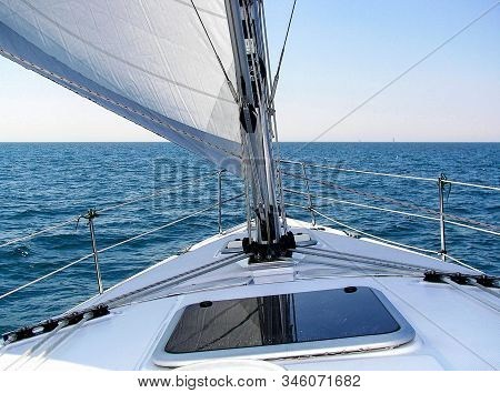 Sailboat Deck View With Mast And Sail On Lake Michigan Blue Water