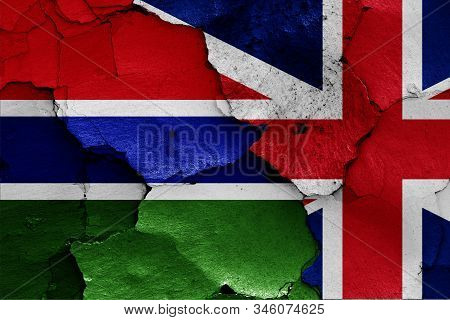 flags of Gambia and UK painted on cracked wall poster