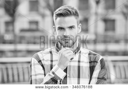 Trim Or Shave. Unshaven Guy Touch Beard Hair Outdoor. Handsome Man Wear Beard. Bearded Man With Styl