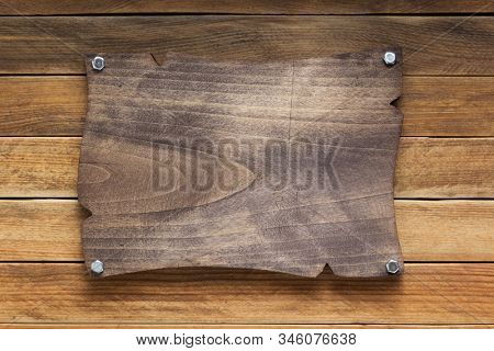 nameplate or wall sign at  wooden background texture surface, with screws