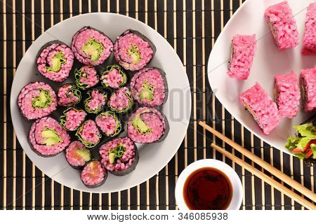 vegetarian maki roll with soy sauce- maki cooked with beetroot and avocado
