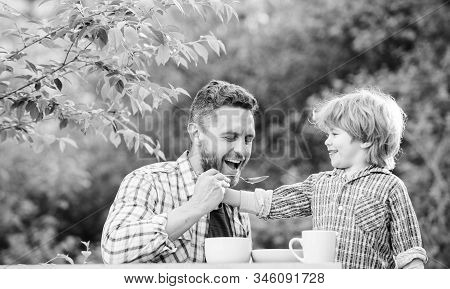 Feed Son Solids. Feed Your Baby. Natural Nutrition Concept. Dad And Cute Toddler Boy Having Lunch Ou