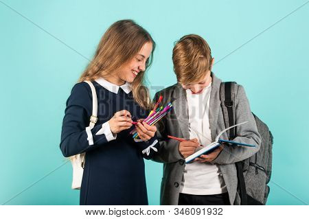 Before Examination. Small Children Prepare For Examination. Little Girl And Boy Hold Examination Pap