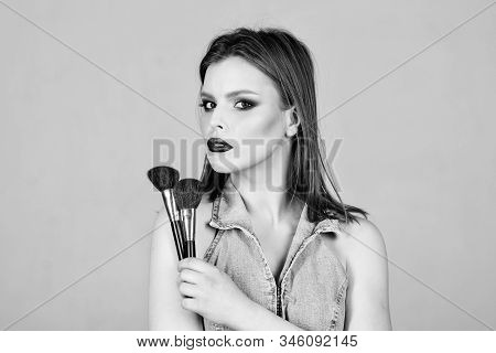 Looking Good And Feeling Confident. Makeup Dark Lips. Attractive Woman Applying Makeup Brush. Profes