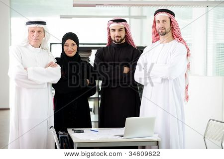 Successful and happy business arabic people standing for a meeting