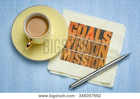 goals, vision, mission - word abstract in vintage letterpress wood type on a napkin with a cup of coffee, business, career or personal development concept