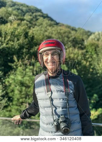 Happy Adult Photographer With Red Helmet Getting Ready To Ride An All Terrain Vehicle. Outdoor Activ