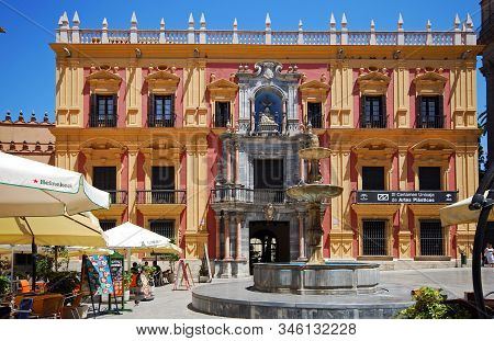 Malaga, Spain - July 11, 2008 - Stone Fountain In Obispo Square With The Episcopal Palace To The Rea