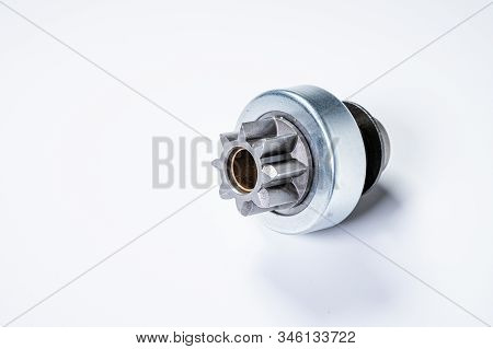 New Spare Parts - Starter Gear Drive For Motor Starter On A Gray Background. Classic Gear Transmissi